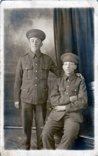 Lionel (seated) and his cousin in their Wiltshire Regiment uniform, 1914