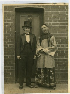Fred and Maud (Iris' grandparents) standing outside the doorway of 58 Greencroft Street dressed for the Street VE Day fancy dress party. | Iris Evans