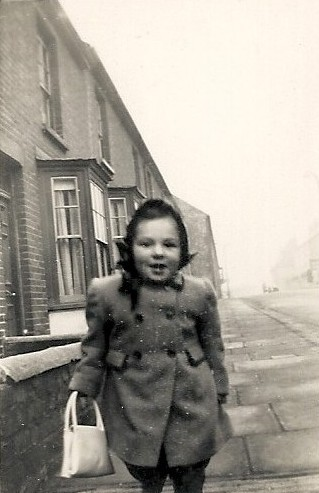 I was about three when this picture was taken. At the time, I was probably walking home from my great aunt's house which can be seen in the background. | Photograph by kind permission of the Jacob family