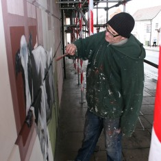 Fred painting the cow, which has gone astray into Fosters Bakery! March 2011 | Anna Tooth