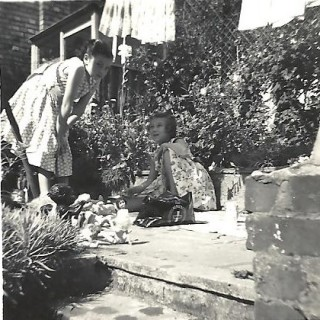 In the 1920s, children could play outside their homes in Rampart Road but, with the increase in traffic, it became too dangerous to do so. In the 1950s, children either played in gardens or went to the designated play areas, this photograph showing the garden of Number 16. | Picture by kind permission of the Jacob family