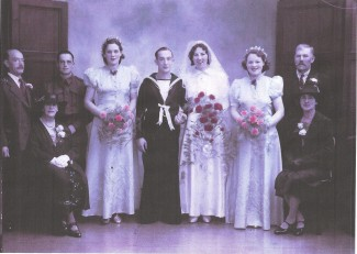 Phyllis married Reginald Percy Maple on 8 October 1941. They met at Salisbury station where they both worked and should have married in 1939 but the new bungalow that they wanted had been sold. By the time the wedding was able to take place war had been declared and Reginald was in the Royal Navy. Like most formal wedding photographs, this would have been taken at a studio after the ceremony. | Picture by kind permission of the Maple family