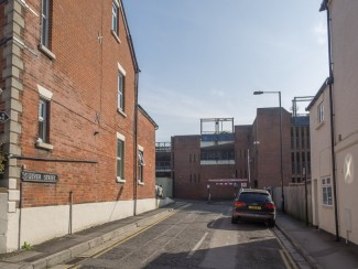 Stand 8 - Entrance to Culver Street, once a lively street. Demolished to make way for car park. | Photo John Palmer 2014