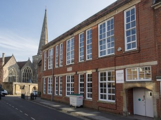 St. Martin's Infant School appeared more forbidding in the 1950s; the windows then being similar to those in a church and covered in netting on the ground floor. | Photo John Palmer 2014