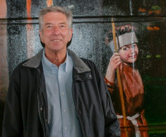 Richard Webb at the official opening of the Jubilee Mural, next to the image of him dressed as Friar Tuck | Anna Tooth