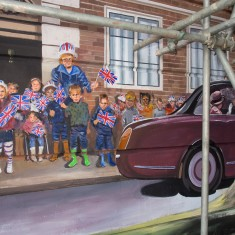 Children watching Her Majesty's car pass in the Jubilee Mural | John Palmer