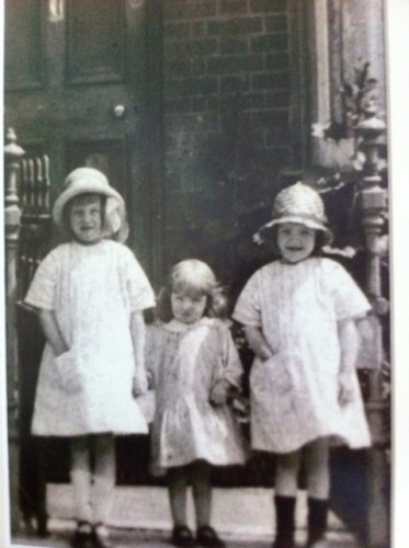 My mother and her sisters outside their house in Rampart Road. c. 1930. Left to right Norah (7 ), Barbara (4) and Freda (6) Ireland. My mother is on the right.