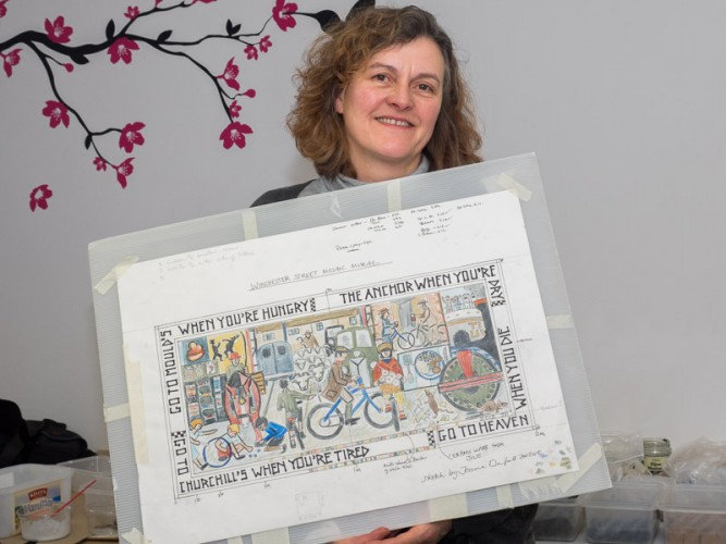 Joanna Dewfall holds up her design for the Winchester Street mosaic | Photo John Palmer