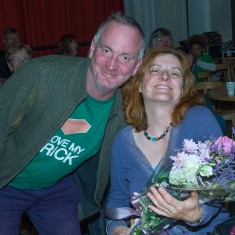 Mosaic artist Joanna is presented with a bouquet to thank her for all of her hard work, by Finbarr (project volunteer) | John Palmer