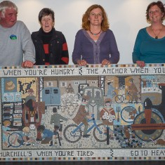 Pat Shelley of Salisbury and Stonehenge Tours who gave some money towards the mosaic; Mary Stephens (Treasurer); Joanna Dewfall (Mosaic Artist) and Clare Christopher (Project Co-ordinator) behind the newly unveiled mosaic. | John Palmer