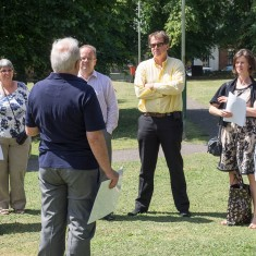 George Fleming describes the Memory Walk to our visitors before taking them to see the mosaic and the murals   John Palmer