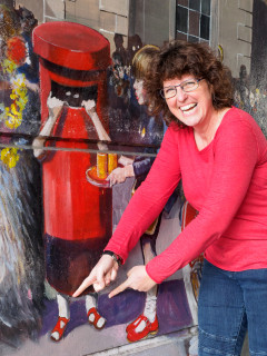Lisa Parrott, the girl in the pillar box in the Jubilee Mural, admires her former taste in footwear | John Palmer
