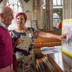 Project Co-ordinator Clare Christopher explains to a visitor what the mosaic is about