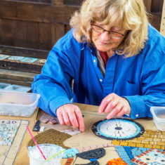Volunteers on day 3 of making the Greencroft Street mosaic