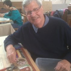 Day 2 of making the Greencroft Street Mosaic, 30th September 2017. Ken Edwards adds a tile to the image of himself as a young boy, collecting beer from the