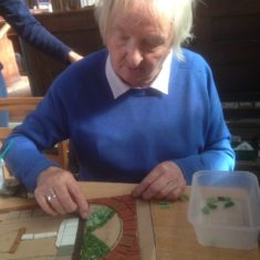 Day 2 of making the Greencroft Street Mosaic, 30th September 2017. Jan Truckle grew up on Greencroft Street and remembers having an outside loo, shared with other houses. We added that to the design and here she is adding some tiles!