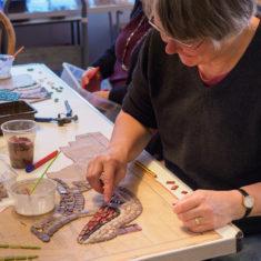 Christine making some lizard-skin shoes | John Palmer