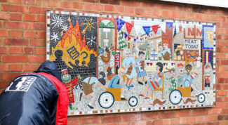 Putting the Greencroft Street mosaic up - in the pouring rain | Spencer Mulholland