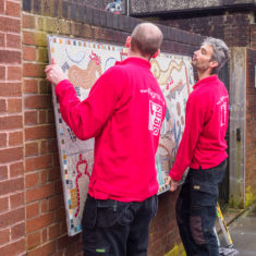 Nathan and Jonathan from T-signs getting the mosaic in place on the morning before the unveiling. | John Palmer